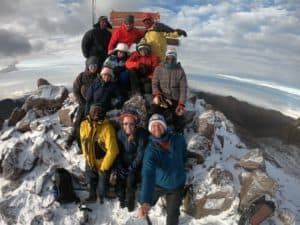 Anna Hemmings and her team at the summit of Mount Kenya