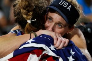 USA Womens Volleyball team celebrate victory at the Olympic Games - showing the the importance of teamwork